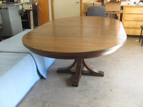 Gorgeous pedestal extension dining table, solid oak, by Huston and Company