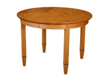 Element Table, round. Shown in cherry with wenge details.